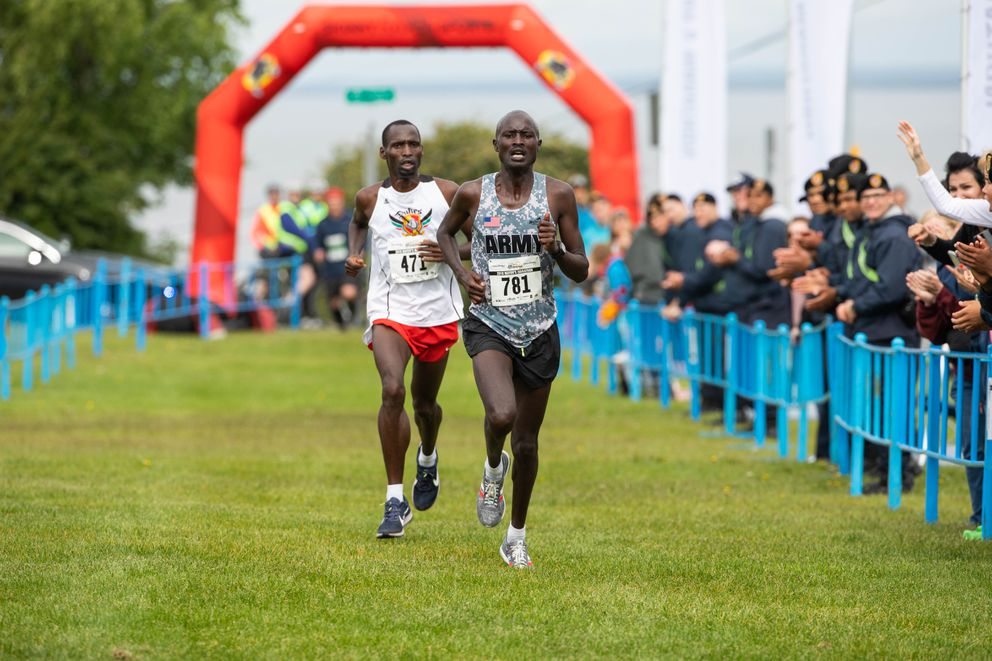 David Kiplagat leads brother Paul Rottich, down the finish chute. Kiplagat won in 2:25:43, one second ahead of Rottich. (Loren Holmes / ADN)