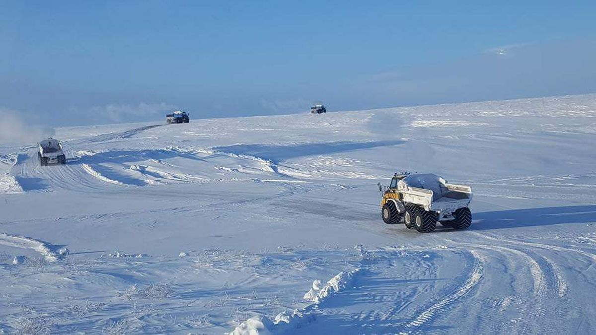 A convoy of Cruz Construction trucks returns to Utqiagvik on a 65-mile snow trail after delivering gravel to the village of Atqasuk in March 2017. (Photo provided by Cruz Construction)