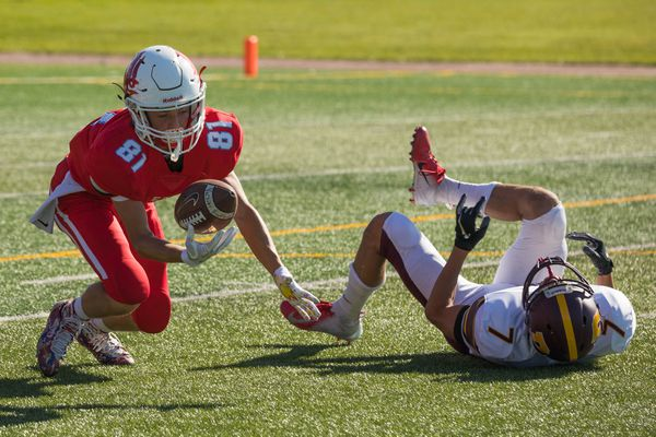 East's Jordan Holland recovers a fumble during a football game against Dimond on Saturday at East High. East won 47-0. (Loren Holmes / ADN)