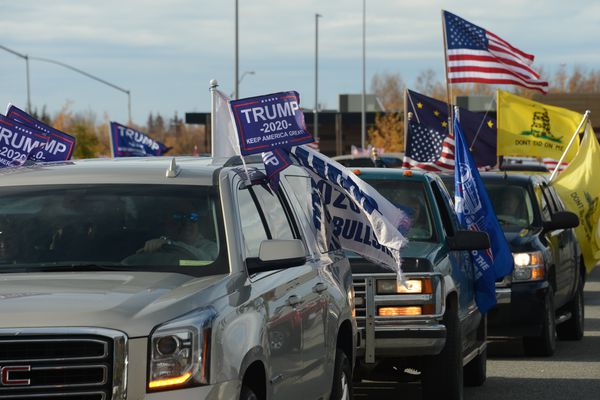 Cars line up in the parking lot of the Anchorage Cabela's store ahead of a convoy supporting President Donald Trump's re-election campaign on Saturday, Oct. 3, 2020. (James Brooks / ADN)