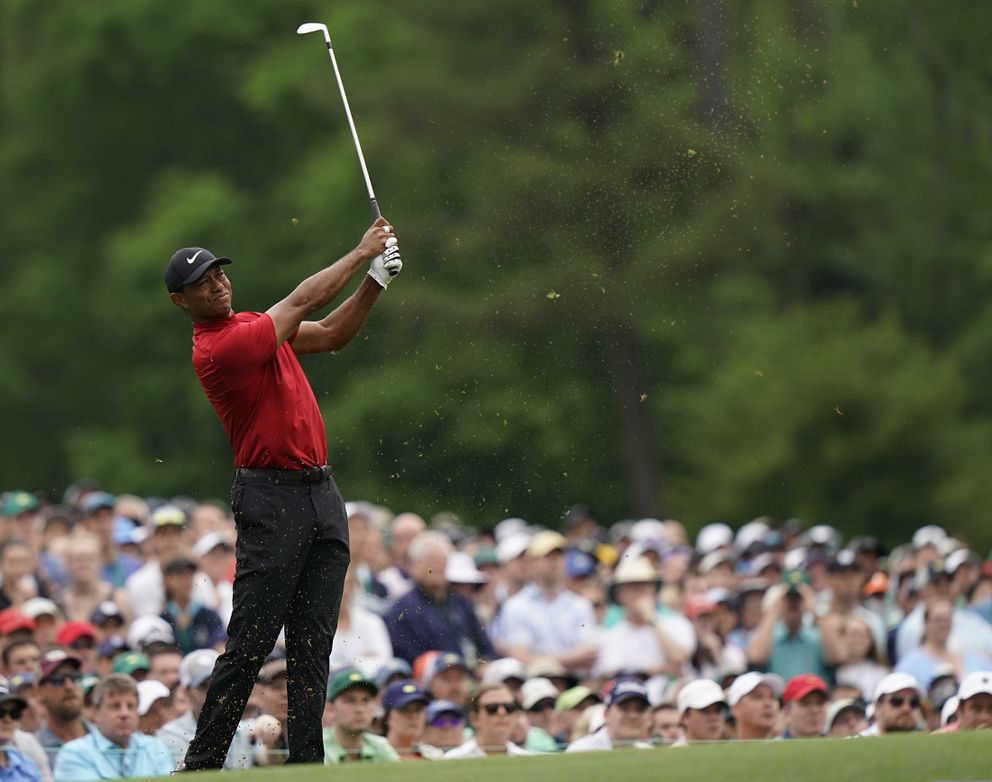 Tiger Woods hits on the 12th hole during the final round for the Masters golf tournament, Sunday, April 14, 2019, in Augusta, Ga. (AP Photo/David J. Phillip)