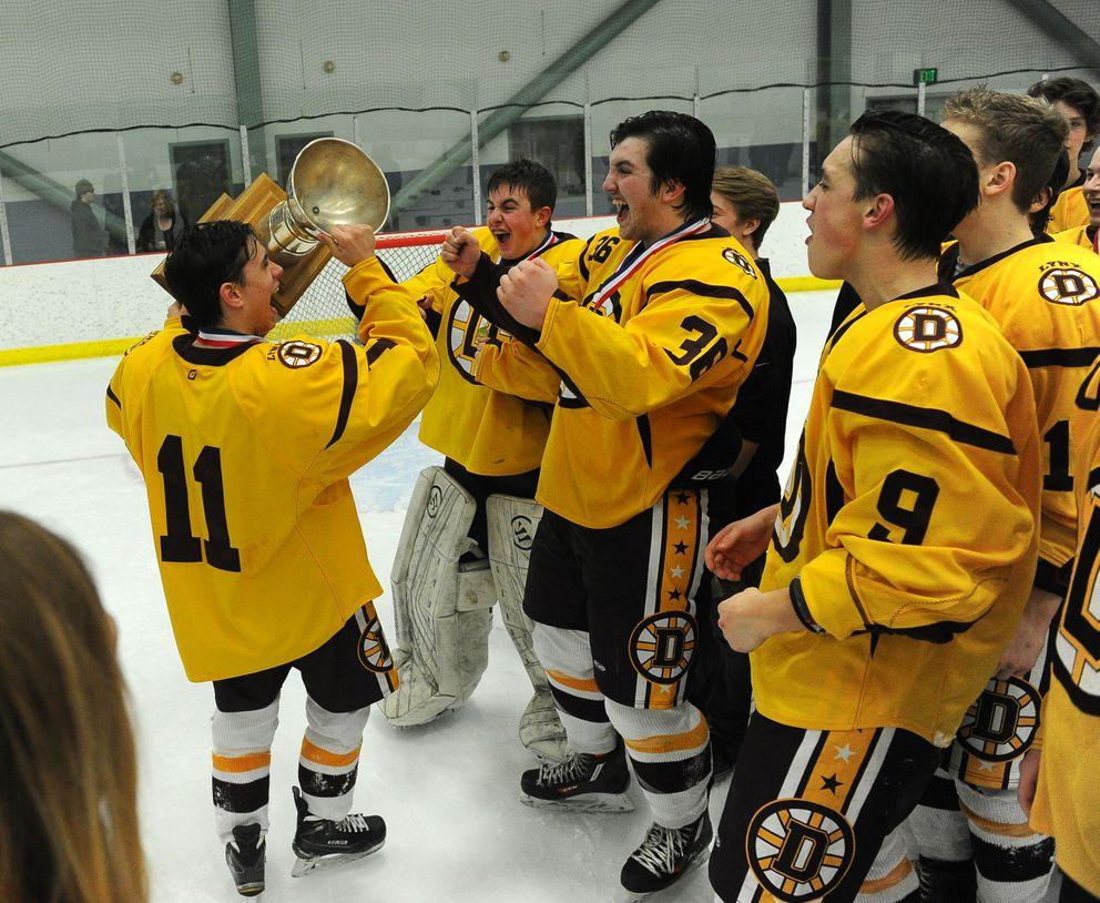 Gavan Hardy, Hunter Kattness, Blake Hausinger, Jaiden Gibson and the rest of the Dimond Lynx celebrate theirtitle. (Bob Hallinen / ADN)