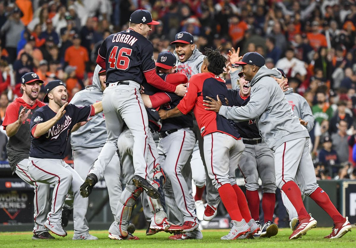 The Washington Nationals celebrate beating the Houston Astros, 6-2, in Game 7 of the World Series at Minute Maid Park on Wednesday night. MUST CREDIT: Washington Post photo by Jonathan Newton