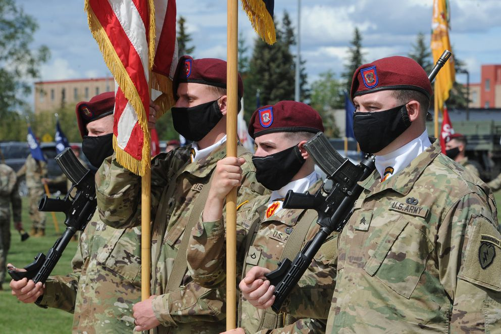 Paratroopers hold the U.S. Flag and Brigade colors as five battalions composing the 4th Infantry Brigade Combat Team (Airborne), 25th Infantry Division held a Change of Command ceremony at Pershing Field on Joint Base Elmendorf-Richardson on Thursday. (Bill Roth / ADN)