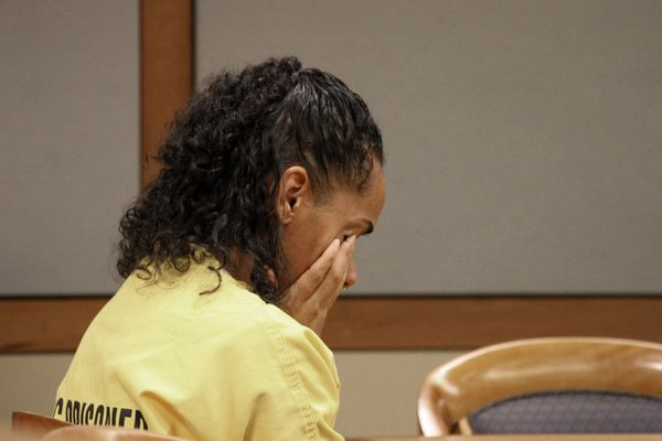 Gina Virgilio cries at the defense table Friday, Oct. 4, 2019, in Anchorage Superior Court, where her sentencing began after pleading guilty to killing her boyfriend, Michael Gonzalez in 2012 by dousing the couch he was sleeping on with gasoline and setting it on fire. Friday's proceedings included family impact statements, and will continue on Monday, Oct. 14, 2019. (AP Photo/Mark Thiessen)