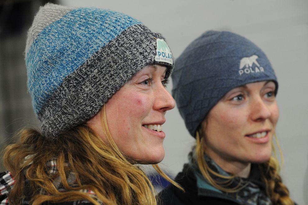 Iditarod veteran mushers Anna Berington, left, and twin Kristy Berington at the food drop on Wednesday. (Bill Roth / ADN)