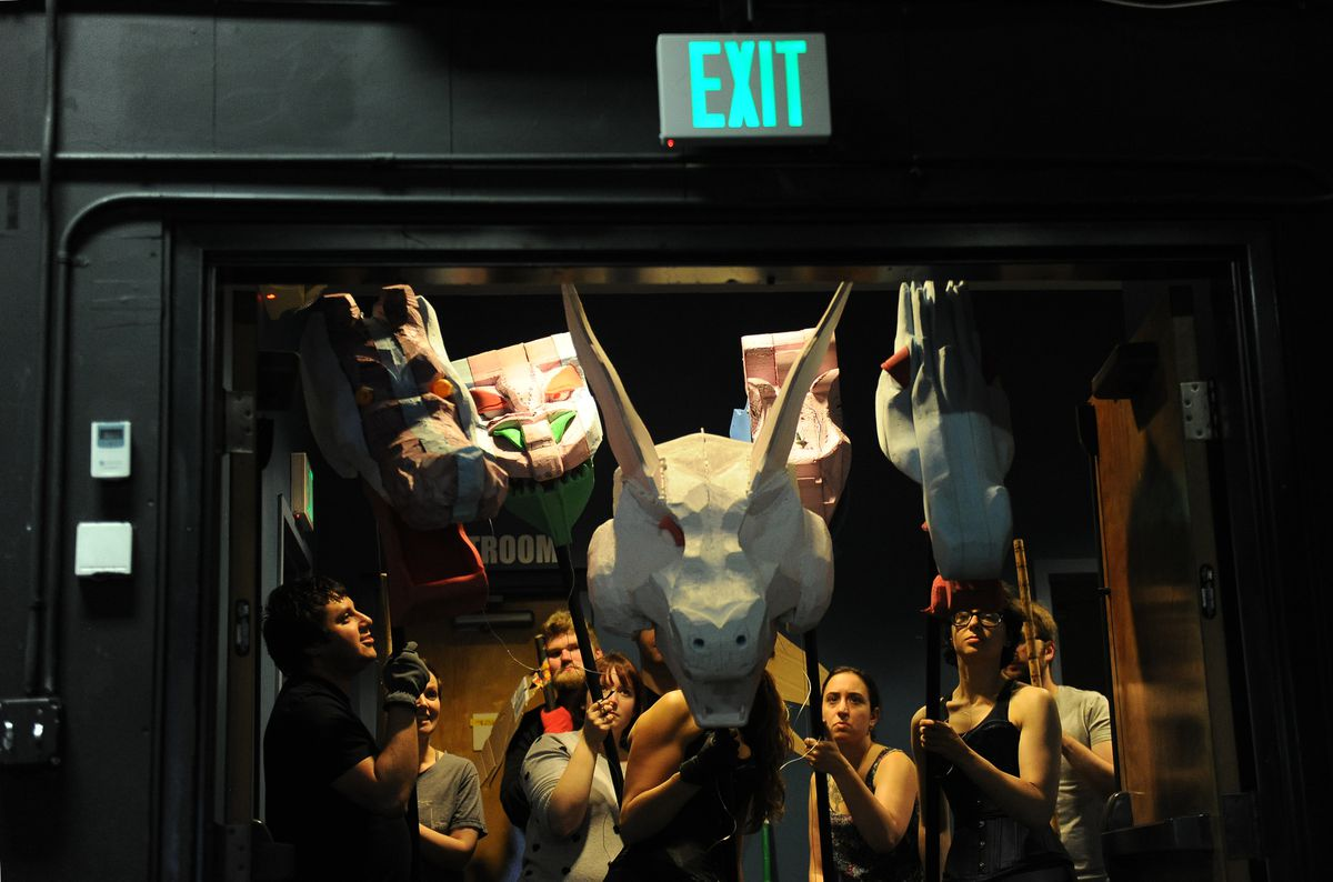 "The dragons wait to make their entrance during a fight scene rehearsal for the production of ""She Kills Monsters"" in Anchorage on Sept. 5. (Bob Hallinen / Alaska Dispatch News)"