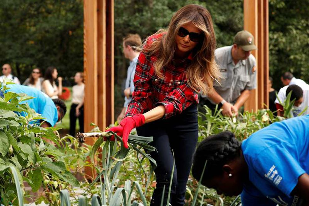 First Lady Melania Trump works in the White House kitchen garden with students September 22, 2017. — Reuters
