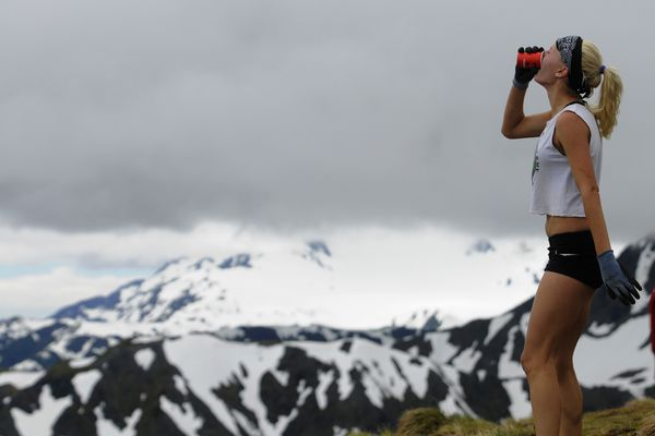 Denail Foldager-Strabel, seen her grabbing a quick drink atop Mount Marathon on the way to a fifth-place finish last year, should again be among the fastest women in Monday's 89th edition of the race in her hometown of Seward (Marc Lester / ADN)