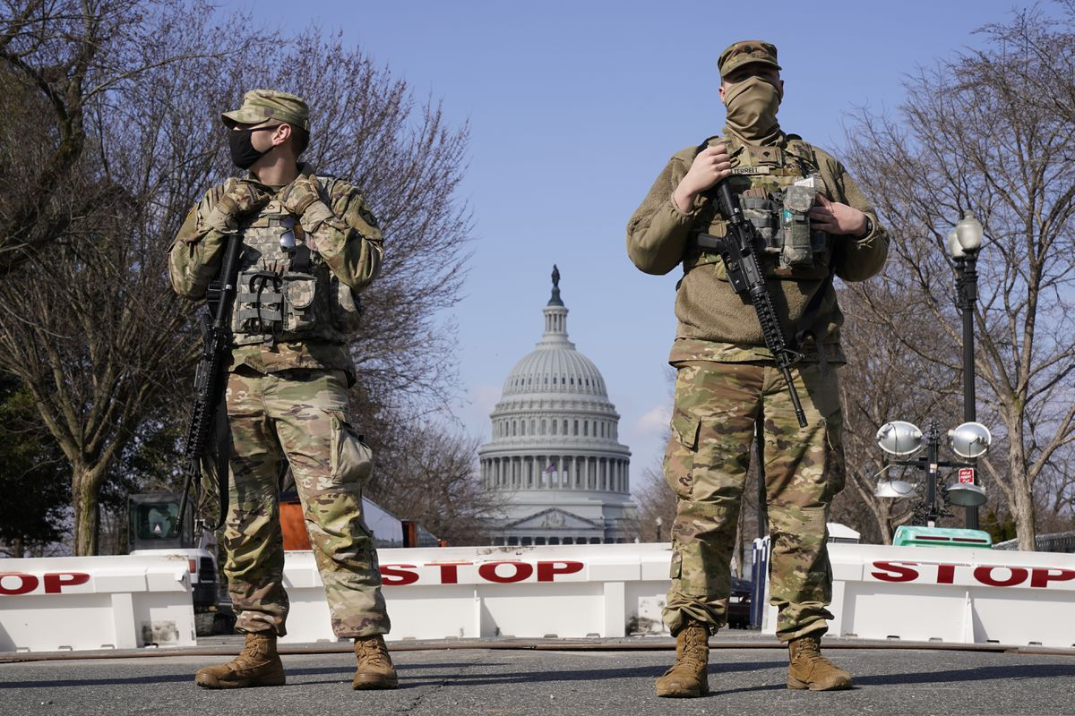 National Guard keep watch on the Capitol, Thursday, March 4, 2021, on Capitol Hill in Washington. Capitol Police say they have uncovered intelligence of a