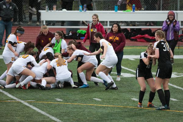 Dimond girls celebrate winning the state soccer championship against South Saturday, May 25, 2019 during the state high school soccer match at Service High. (Loren Holmes / ADN)