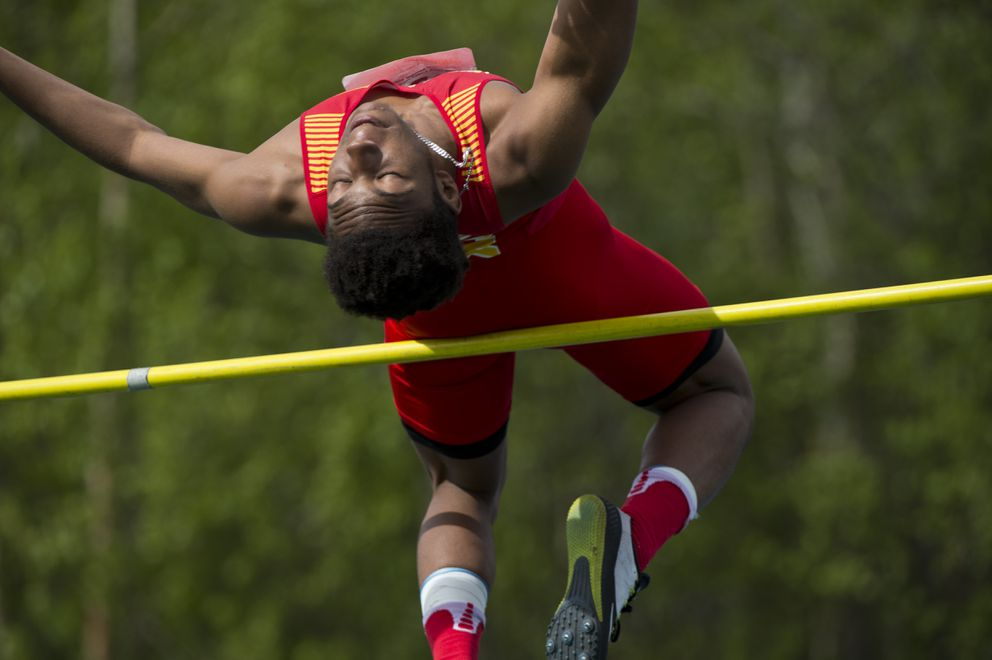 Terrell Johnson of West Valley clears the bar en route to a second-place finish in the high jump. (Marc Lester / ADN)