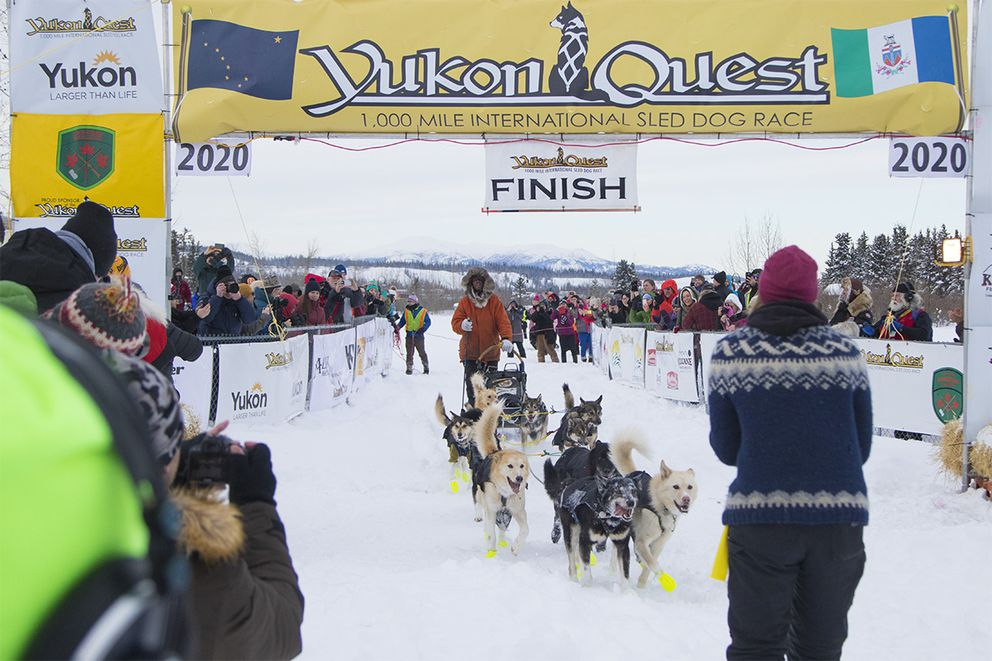 Brent Sass crosses the Yukon Quest 1,000 Mile International Sled Dog Race finish line in Whitehorse on Feb. 11 just before 3 p.m. local time to claim a first place victory for his second year in a row. (Crystal Schick / Yukon News)
