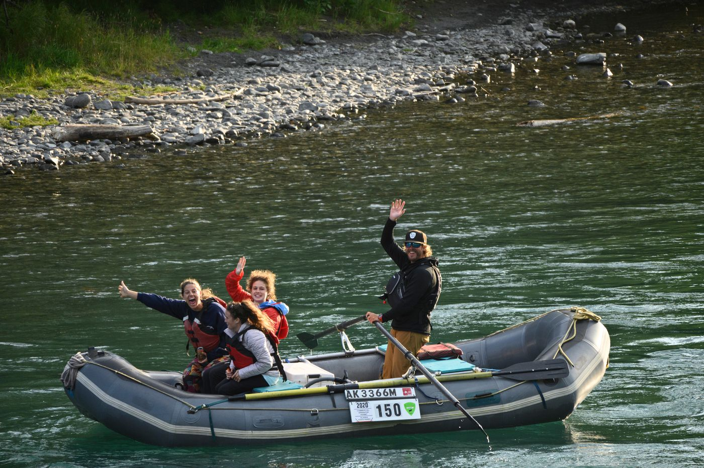 Rafters show excitement after spotting bears during their float on the Kenai River on July 30, 2020. From left are Sami Lucci of Richmond, Virginia, Sarah Ross and Kirsten Baker, both from Denver. Austin Klopstein of Alaska River Adventures guides the float. (Marc Lester / ADN)