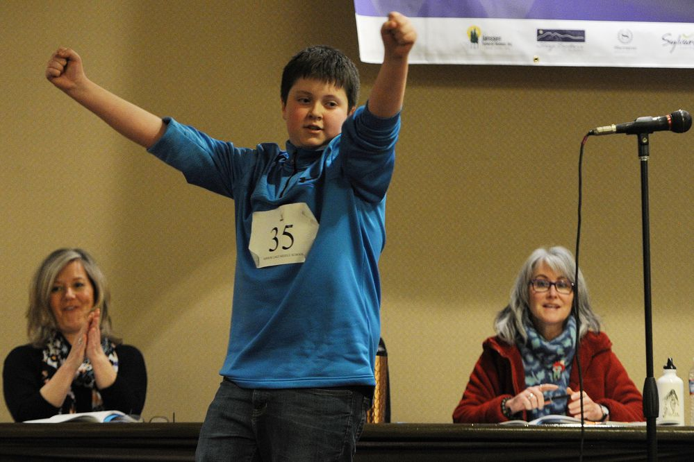 Joshua Saylor, a seventh-grade student at Mirror Lake Middle School, reacts to winning the Alaska State Spelling Bee for the second year in a row after correctly spelling the word