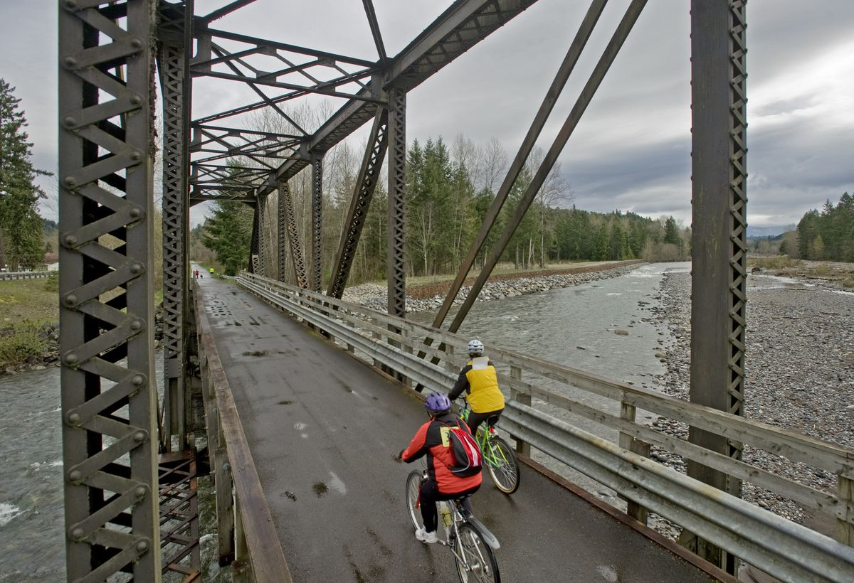 Biking over the Carbon River on the Foothills Trail in Tacoma, Wash. (Peter Haley/Tacoma News Tribune/MCT)