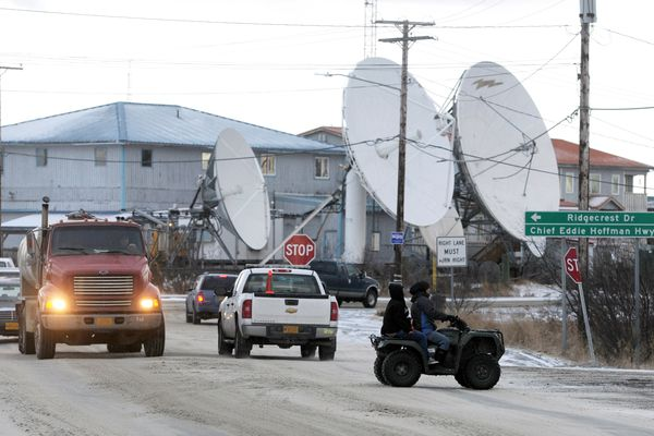 A four-wheeler crosses past traffic in January of 2015 in Bethel. (Bill Roth / ADN archive 2015)