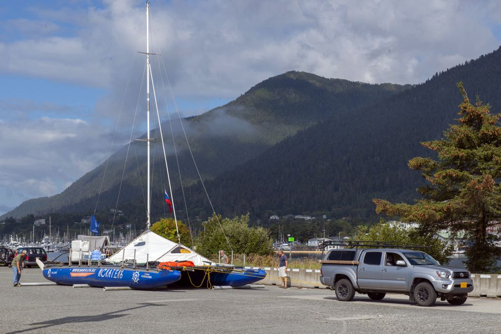 In this Thursday, Aug. 28, 2019 photo, the Iskatel, a Russian inflatable catamaran sailboat, is towed by skipper Anatoly Kazakevich to a spot on the parking lot near the University of Alaska campus in Sitka, Alaska. The boat is on a multi-year expedition from Lake Baikal in Siberia to Alaska. (James Poulson/The Daily Sitka Sentinel via AP)