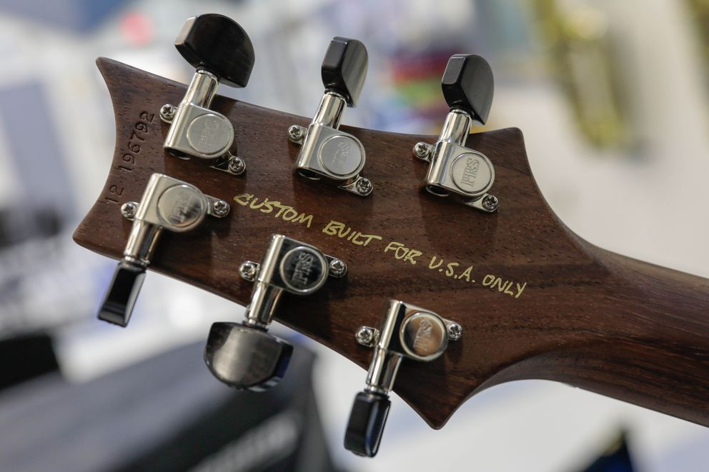 'Custom built for U.S.A. only ' is written on the back of a custom Paul Reed Smith 24-fret double-cutaway electric guitar, shown Wednesday at East High School. (Loren Holmes / ADN)