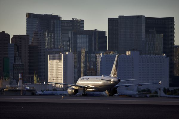 FILE - In this May 16, 2016, photo, a plane taxis toward the terminal after landing at McCarran International Airport in Las Vegas. Federal and airport authorities said Friday, Nov. 9, 2018, they are investigating why an air traffic controller became incapacitated and went silent while working a night shift alone in the tower at busy McCarran International Airport. Five inbound aircraft remained airborne during the incident, and aircraft on the ground held positions or communicated between themselves to maintain safety while moving, the FAA said. (AP Photo/John Locher, File)