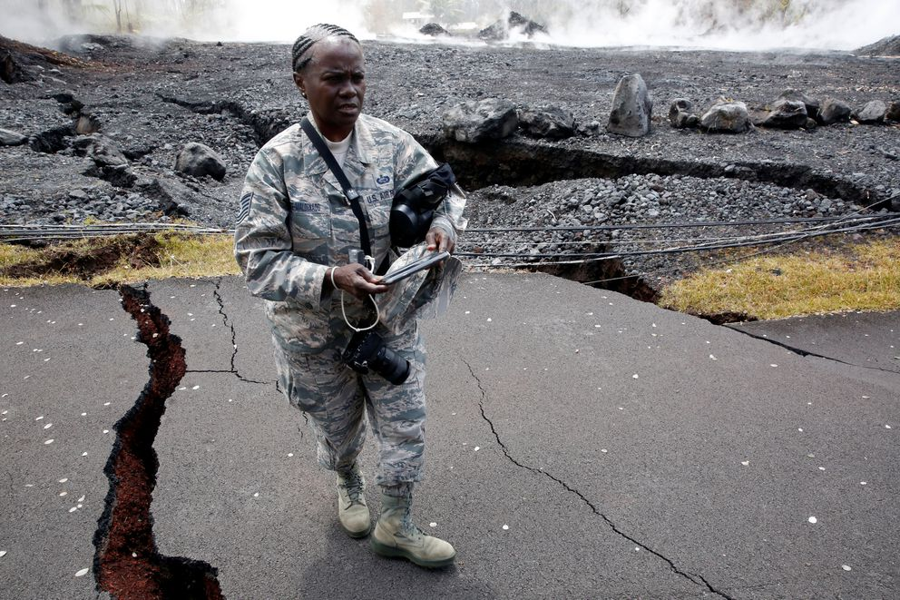 Technical Sergeant Alison Bruce-Maldonado of the Hawaii National Guard documents road damage in Leilani Estates during ongoing eruptions of the Kilauea Volcano in Hawaii, U.S., May 18, 2018. REUTERS/Terray Sylvester