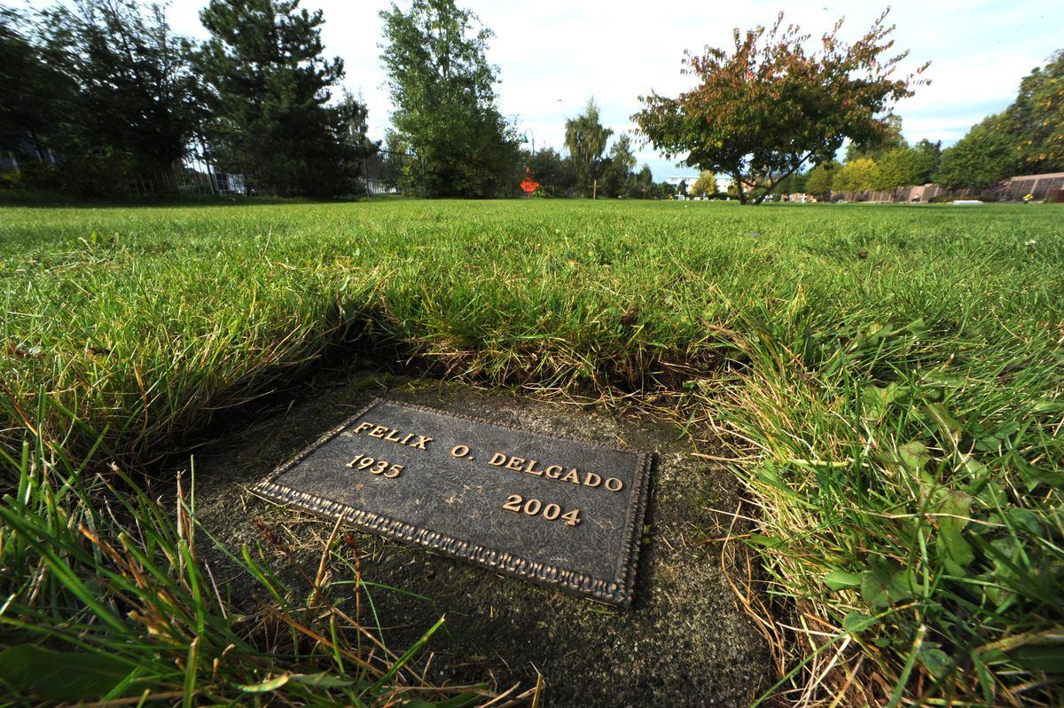 Felix Delgado's grave at the Anchorage Memorial Park Cemetery. The state of Alaska holds close to $80,000 that was owed to him and remains unclaimed. (Bill Roth / Alaska Dispatch News)