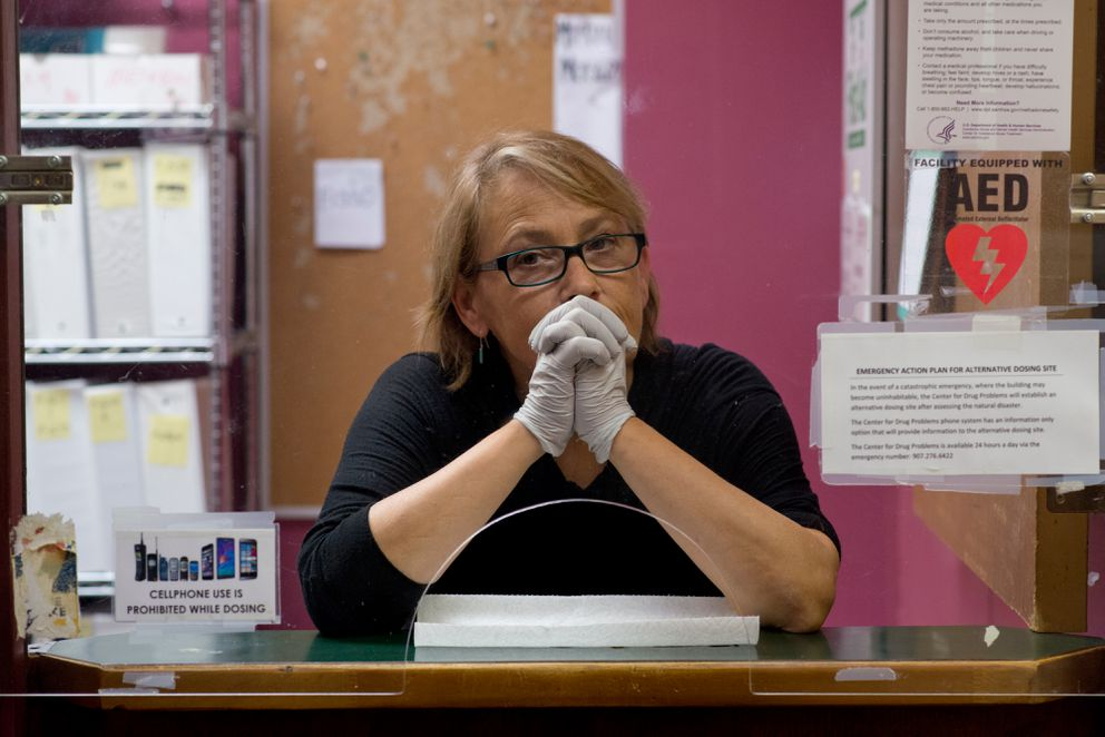 Registered nurse Mimi DeGange operates the dispensing window at the Center for Drug Problems in Anchorage on Wednesday, Aug. 17, 2016. The clinic uses methadone to treat people with opioid addictions. (Marc Lester / Alaska Dispatch News)