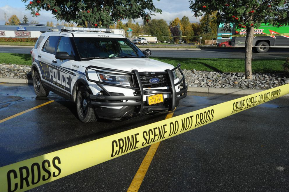 An Anchorage police vehicle was damaged during an attempt to halt thesuspects' vehicle. (Bill Roth / Alaska Dispatch News)
