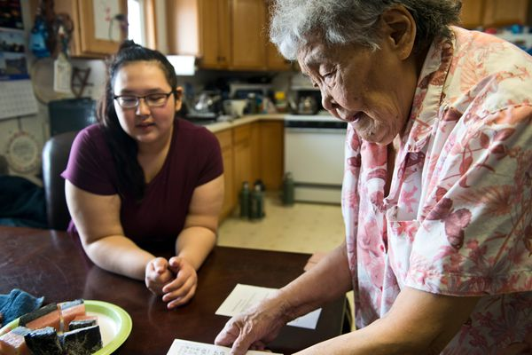 Pictured: Lillian Nageak, right, spends time at home in Barrow with her granddaughter, Michelle Kaleak, 17.
