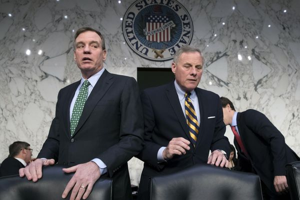 FILE - In this March 21, 2018 file photo, Senate Intelligence Committee Vice Chairman Mark Warner, D-Va., left, and Chairman Richard Burr, R-N.C., hold a hearing to examine efforts to secure state election systems and to safeguard against foreign meddling in elections, on Capitol Hill in Washington. The Senate intelligence committee has concluded that the Kremlin launched an aggressive effort to interfere in the 2016 presidential contest on behalf of Donald Trump. The Republican-led panel on Tuesday released its fifth and final report in its investigation into election interference. (AP Photo/J. Scott Applewhite)