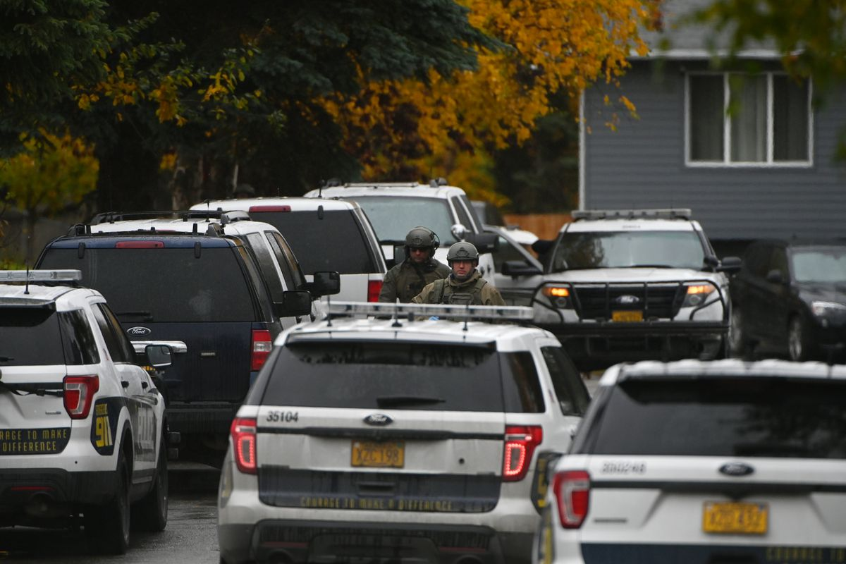 The Anchorage Police Department SWAT team arrested a suspect in a shooting investigation off Dimond Boulevard on Monday, Sept. 28, 2020. (Bill Roth / ADN)