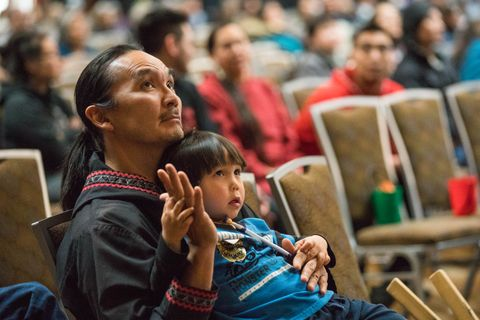 Aassanaaq Kairaiuak teaches his son Linson Kairaiuak, 3, some dance moves while they watch a performance by a Maori group Saturday, Oct. 21, 2017 at the Alaska Federation of Natives Convention. Both Kairaiuaks and Linson's mother Polly Andrews performed with the group Acilquq during the Indigedance finals, placing first and taking home a $10,000 prize. (Loren Holmes / Alaska Dispatch News)
