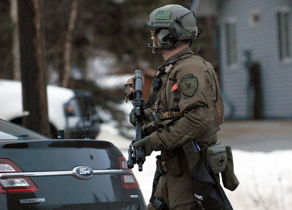 An Anchorage Police Department SWAT officer walks down Eagle River Road following a standoff with a reportedly armed and suicidal man on Friday, March 22, 2019. The man was taken into custody shortly before 8 p.m. (Matt Tunseth / ADN)