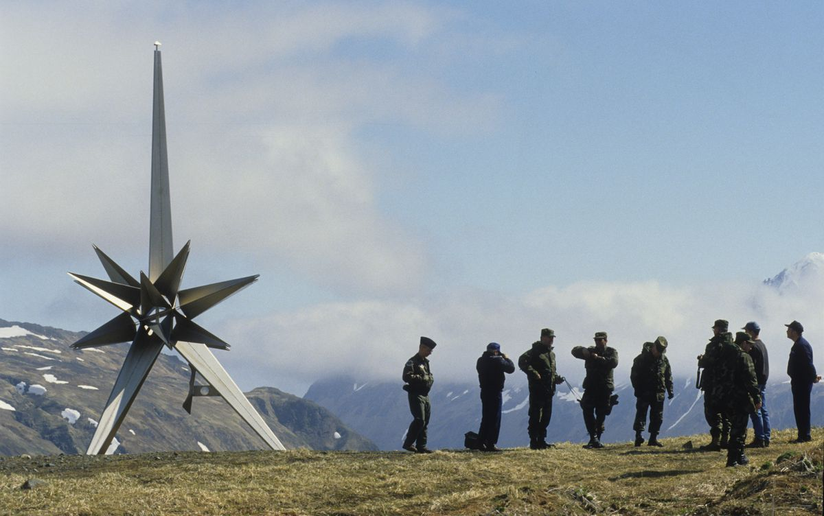 Members of the U.S. military stand near the peace memorial placed on Attu Island by the Japanese as they study the battle on Engineer Hill where thousands of Americans and Japanese died during the Aleutian Campaign of World War II in June of 1997. (Bill Roth / ADN archive 1997)