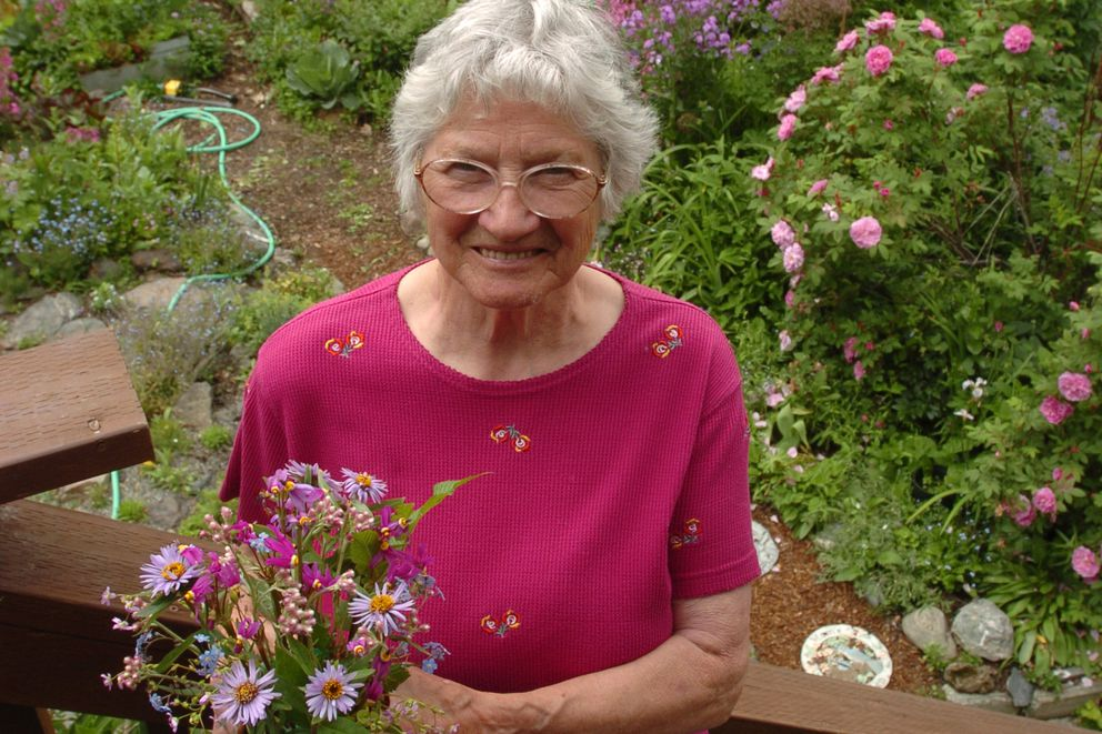Verna Pratt holds a wild flower arrangement which has Shooting Star, Pink Pussy Toes, Siberian Aster, Forget-Me-Not and Siberian Spring Beauty at her East Anchorage home June 3, 2007. (Bob Hallinen / ADN archive 2007)