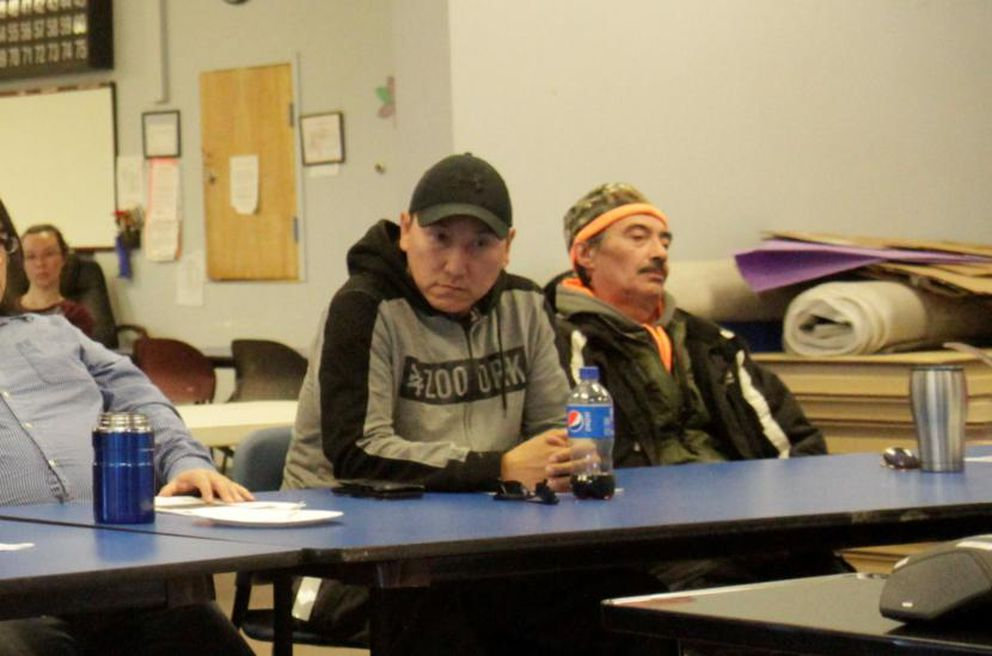 Charles Lampe, a whaling captain and Kaktovik Inupiat Corp. board member, sits at a community meeting in Kaktovik last month. (Photo by Nat Herz/Alaska's Energy Desk)