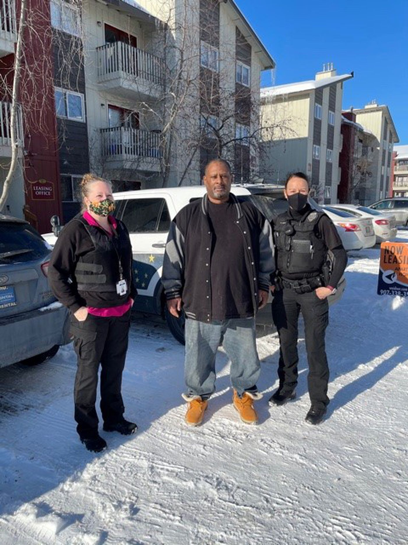APD CIT Officer Ruth Adolf and Behavioral Health Counselor Tanya Vandenbos conducting some community outreach with Kareem Waugh - maintaining positive relationships helps community members feel connected and healthy. Photo Credit: Anchorage Police Department
