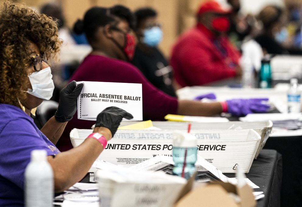 Absentee ballots and overseas ballots are received and processed at the elections preparation center at State Farm Arena in Atlanta on Nov. 3. (Washington Post photo by Melina Mara)