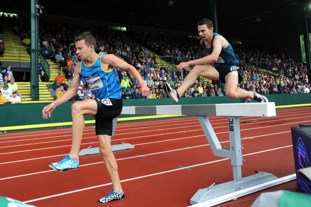 Isaac Updike, right, clears a barrier on the backstretch en route to a 12th-place finish at the 2016 U.S. Olympic Trials. (Erik Hill / ADN archives)