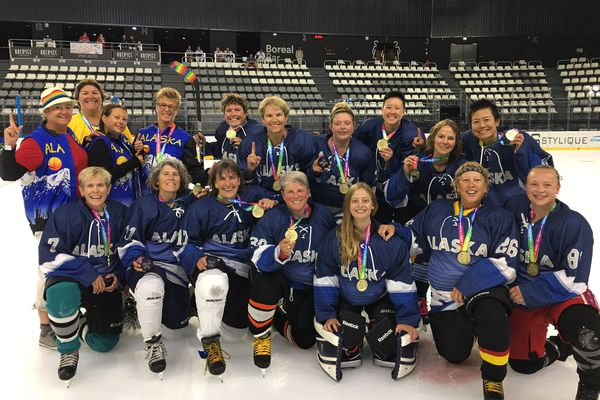 Members of the Alaskan Ice women's hockey team pose with their gold medals in Aug. 2018 at at the Gay Games in Paris. (Photo courtesy of Hilary Morgan)
