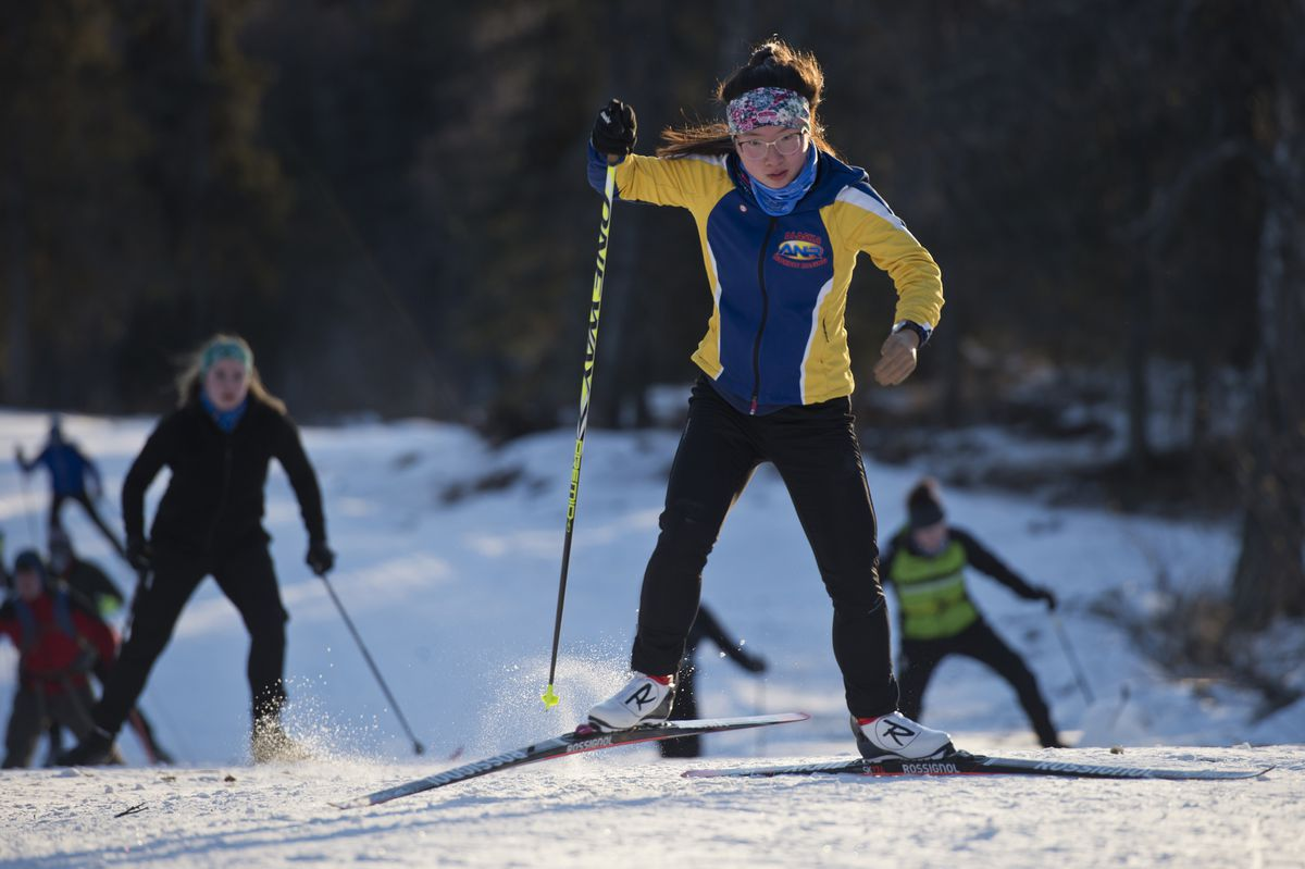 Grace Miller trains with the Palmer High cross country ski team at Government Peak Recreation Area on Thursday. Her left hand is prosthetic and she wears it sometimes while training but not when racing. (Marc Lester / ADN)