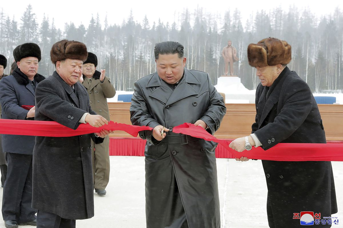 In this Dec. 2, 2019, photo provided by the North Korean government, North Korean leader Kim Jong Un, second right, attends a ribbon-cutting ceremony of the Township of Samjiyon County in North Korea. The content of this image is as provided and cannot be independently verified. Korean language watermark on image as provided by source reads:
