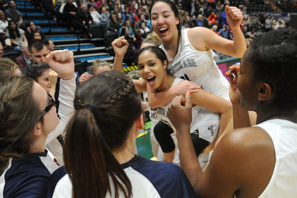 Anchorage Christian celebrates their win over Sitka 56-46 in the championship game of the 3A girls Alaska State basketball tournament at the UAA Alaska Airlines Center in Anchorage, Alaska on Saturday, March 24, 2018. (Bob Hallinen / ADN)