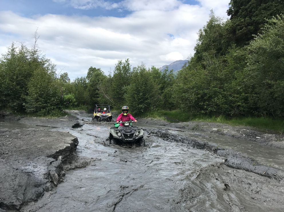Alli Harvey, trailed by Wes and Reesa Hoskins in the side-by-side, en route to Knik Glacier in the Jim Creek area. (Photo by Bryan Scoresby)