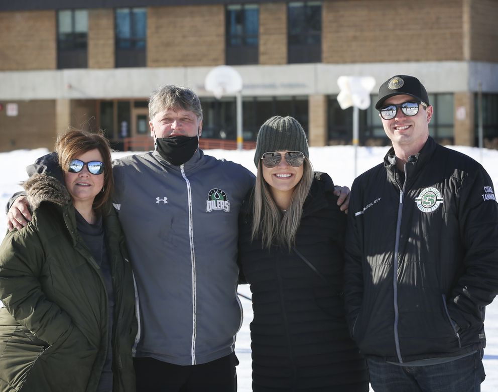 From left, Lee Twait, Rob Larkey, Alysha Tannahill and Derek Tannahill stand on the ice rink outside of Bayshore Elementary School earlier this month. (Emily Mesner / ADN)