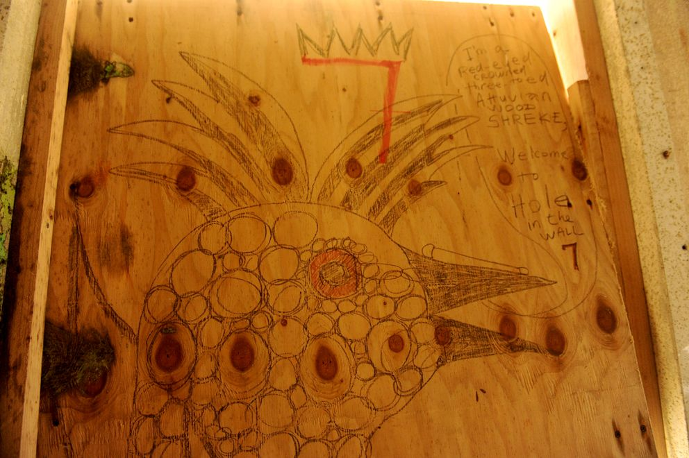 A drawing on a piece of plywood used as a door in an abandoned military building used by birders on Attu Island on June 3, 2015. (Bob Hallinen / Alaska Dispatch News)