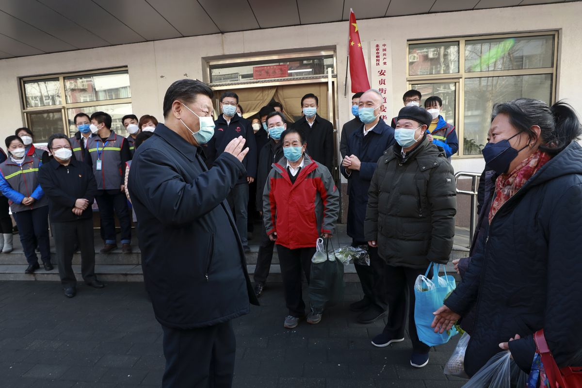 In this photo released by Xinhua News Agency, Chinese President Xi Jinping wearing a protective face mask speaks to residents as he inspects the novel coronavirus pneumonia prevention and control work at a neighbourhoods in Beijing, Monday, Feb. 10, 2020. (Pang Xinglei/Xinhua via AP)