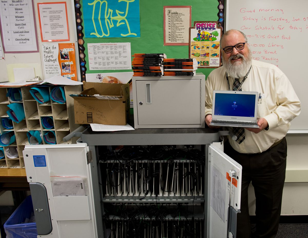College Gate Elementary School sixth-grade teacher Gerald Tennyson has used the DonorsChoose.org website to crowdfund items for his class, including notebook computers, books and clothing. (Marc Lester / ADN)