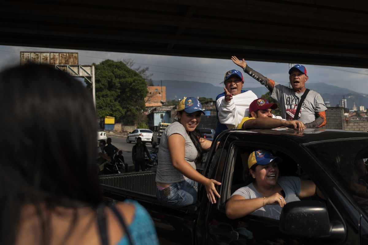 A small group of supporters of the opposition and Juan Guaido shout their support from the back of a truck in San Cristobal, Venezuela on February 21, 2019. (Washington Post photo by Michael Robinson Chavez)