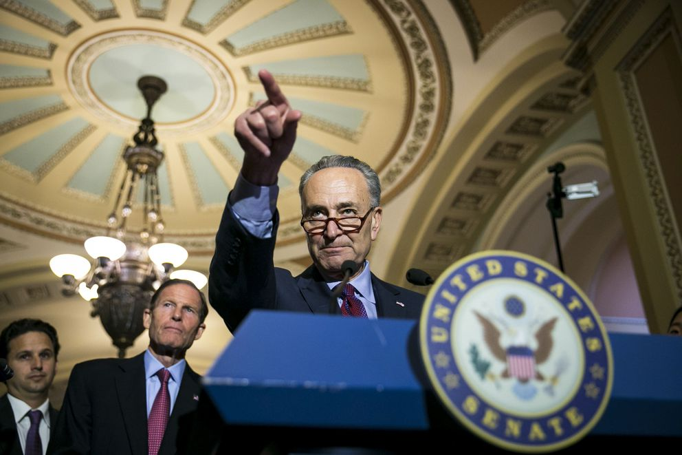 Senate Minority Leader Chuck Schumer (D-N.Y.) speaks during a news conference after the weekly Senate Democrats policy luncheon on Capitol Hill in Washington, May 16, 2017. From left: Sen. Brian Schatz (D-Hawaii), Sen. Richard Blumenthal (D-Conn.) and Schumer. (Al Drago/The New York Times)